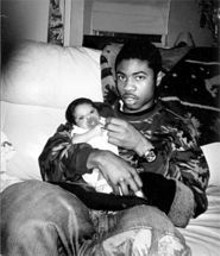Robert Lee Walker with his son, Elijah, who was born just three months before his father's murder.