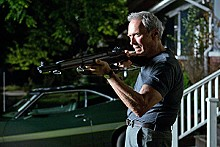 Clint Eastwood takes aim at the neighborhood gang in Gran Torino.