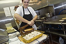 JENNIFER SILVERBERG - Blanca Delatorre makes fresh corn tortillas in a wood press at Tower Tacos.