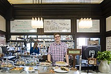 JENNIFER SILVERBERG - Sweet Home: Barista Kevin Maffitt and a few of Winslow's many baked goods.