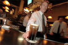 JENNIFER  SILVERBERG - Guinness is good for you: Donovan Buechel serves a perfect - pint.