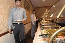 JENNIFER  SILVERBERG - Bobby Vaitla joins a co-worker at Flavor of India's excellent lunch buffet.