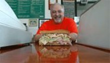 JENNIFER  SILVERBERG - Mouthful of blues: Blues City proprietor Vince Valenza and his Benton Park po'boy.