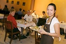 JENNIFER SILVERBERG - Spice is nice: Server Chalita Kanjanasakol delivers a dish at Basil Spice.