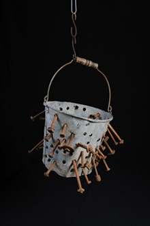 Rick Egea; galvanized steel bucket riddled with rusty nails.