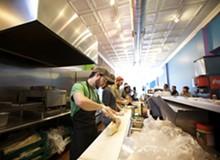 JENNIFER SILVERBERG - Snarf's general manager James Sloan prepares a sandwich.
