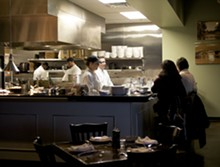 JENNIFER SILVERBERG - The large, open kitchen with counter service at the Tavern Kitchen & Bar.