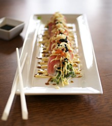 """JENNIFER SILVERBERG - The """"Red Dragon"""" spicy tuna roll comes topped with tuna, smelt eggs and teriyaki sauce. For more photos, check out our slideshow of Fin Japanese Cuisine."""