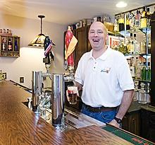 JENNIFER SILVERBERG - St. Louis Brews member Bob Beckmann pours a glass of his homebrew.