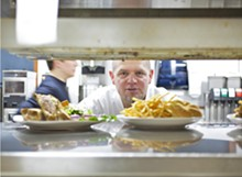 JENNIFER SILVERBERG - Jeff Constance oversees the lunch items as they make their way out to the floor.
