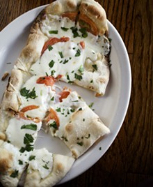JENNIFER SILVERBERG - Caprese flatbread -- stone baked flatbread topped with fresh tomatoes, mozzarella and basil -- is available on the regular and late-night menus.