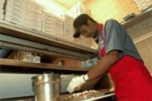 JENNIFER  SILVERBERG - Sicilian spectacular: Skeet Bradley prepares Caito's excellent spinjuine pizza.