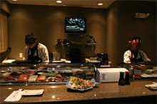MICHELLE  HUDGINS - The fresh-makers: Sushi chefs Paul Kulkanjanatorn (left) and Ray Sae Khow (right) prepare rolls at Oishi.