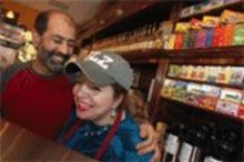JENNIFER  SILVERBERG - Land of java and honey: Belal (left) and Qamar al-Ramahi dish up yummy Middle Eastern food — and nearly 100 coffee creations.