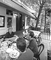 JENNIFER  SILVERBERG - For those who like dining outdoors, Duff's has a perfect patio, umbrellaed by trees.