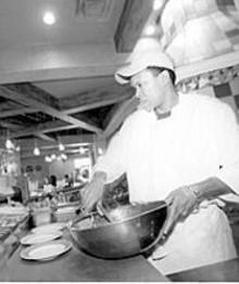 JENNIFER  SILVERBERG - Yia Yia's cook Edson Rocha prepares salads.