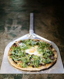 JENNIFER SILVERBERG - Mad Tomato's fungi pizze topped with wild mushrooms, arugula, basil and egg.