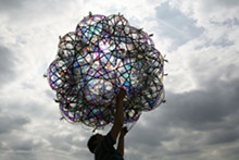 """COURTESY OF THE ARTIST, ANDERSEN€™S CONTEMPORARY, TANYA BONAKDAR GALLERY AND PINKSUMMER CONTEMPORARY ART. - Tomás Saraceno, 32SW Iridescent/Flying Garden/Airport City, 2007. Air pillows, elastic rope, webbing, iridescent foil and pump system, 67"""" diameter."""