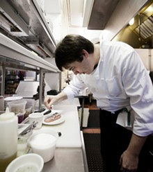 JENNIFER SILVERBERG - New executive chef Jonathan Olson at work in the Market Grill kitchen.