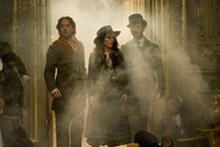 DANIEL SMITH - Get a clue: Robert Downey Jr. as Sherlock Holmes, Jude Law as Dr. James Watson and Noomi Rapace as Madam Simza Heron.