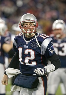 TOM CROKE/ICON SMI - Tom Brady celebrates his fourth-quarter touchdown against the Ravens.