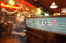 JENNIFER  SILVERBERG - Highway = Heaven: Waiter Colian Spight carries a pint of barbecue's best friend.