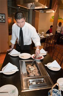 SARAH  CROSS - Sizzlin': After one visit to KoBa, you might want to make Korean barbecue a tradition.