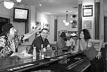 JENNIFER  SILVERBERG - Good sports? Q's regulars Paul Stasiak (left) and - Ernest Pepmiller (right) chat with bartender Chris - Venezia.