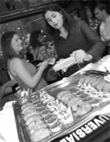 JENNIFER  SILVERBERG - Mixin' it up: Nadia Giannakopoulos (left) and Lisa - Berenson (right) enjoy a private party in Mélange's - front room.