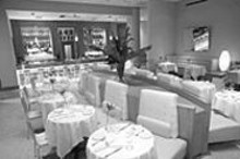 MARK  GILLILAND - The chic décor at The Dining Room at Neiman Marcus will delight you; the food will sweep you off your feet.