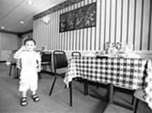 JENNIFER  SILVERBERG - At Pho Saigon, forks are rarely seen and English is used sparingly.