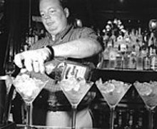 JENNIFER  SILVERBERG - The excellent Warren tends to the Pepper Lounge & Eatery's Guam-sized libations.