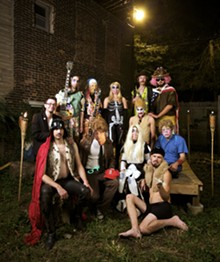JENNIFER SILVERBERG - Counting 'Kraus: Seated: Chizzy Chizmo, Bugatchi Vomo, Larva, Santiago Modern Mounds, Mr. Curious. 2nd row: Mr. Ben, Le' Text Free. Back: Wiggpaw, Hidler Otter, Xteen, Roy Orbisoncheeseburger, Tron Javolta.