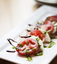 JENNIFER SILVERBERG - Crushed Red serves its fresh mozzarella with tomato, basil pesto and a balsamic reduction.