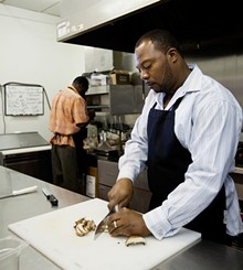 JENNIFER SILVERBERG - Owner DeMarco Howard in Gobble Stop's kitchen. Slideshow: The Dishes of Gobble Stop Smokehouse.