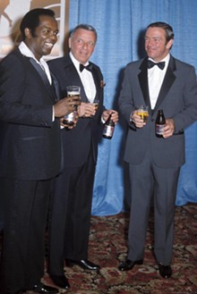 ZUMA WIRE - August Busch III (right) enjoys some of his product with Lou Rawls and Frank Sinatra circa 1982.