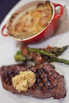 CRYSTAL ROLFE - Prime Angus KC Strip Steak, grilled asparagus and poblano au gratin potatoes. See more photos of J. Gilbert's here.
