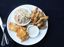 JENNIFER SILVERBERG - The fish and chips is fresh cod that's hand-dipped in beer batter, served here with fried potato wedges, cole slaw and tartar sauce. See also: Inside J Greene's Pub
