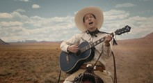 NETFLIX - Buster Scruggs (Tim Blake Nelson) isn't your typical white-hat-wearing, singing cowboy.