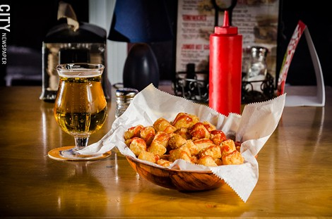 A basket of tater tots with a PBR from Acme Bar and Pizza. - PHOTO BY MARK CHAMBERLIN