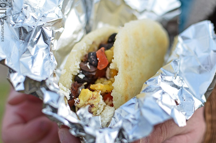 A breakfast arepa stuffed with black beans, egg, and goat cheese from Hello Arepa. - PHOTO BY MATT DETURCK
