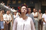 SONY PICTURES ENTERTAINMENT - A chain-smoking landlady with a mean roundhouse: Yuen Qiu in Kung Fu Hustle.