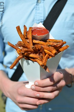 A cone of sweet potato fries. - PHOTO BY MATT DETURCK