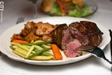 PHOTO BY MIKE HANLON - A filet mignon and vegetables served at Grinnell's. The Monroe Avenue chophouse is a Rochester staple, having existed for more than 50 years.