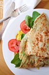 A Florentine crepe, with spinach, tomato, egg, and cheese.