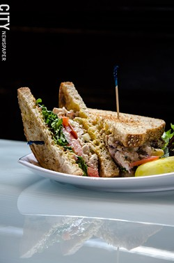 A Founders chicken salad sandwich with lettuce and tomato - PHOTO BY MARK CHAMBERLIN