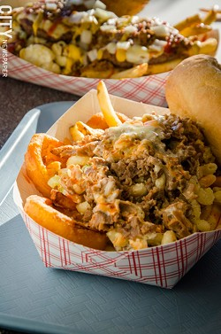 A Philly Plate from Mac's. Traditionally served with steak OR chicken, the one pictured includes both steak and chicken, cheese, mac salad, onion rings, french fries, hot sauce and served with an Amoroso roll. - PHOTO BY MARK CHAMBERLIN