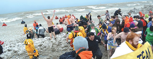 A shot from the 2012 Polar Plunge. The event, in which hundreds of Rochesterians willingly enter the icy waters of Lake Ontario, returns as part of the Lakeside Winter Celebration.