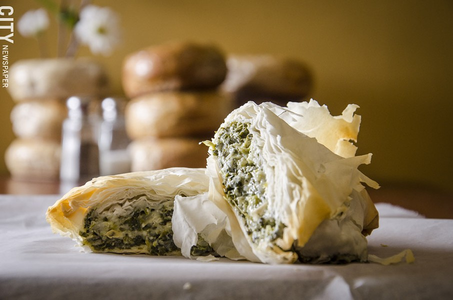 A spinach and cheese phyllo pocket from Balsam Bagels. - PHOTO BY MARK CHAMBERLIN