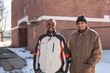 PHOTO BY MIKE HANLON - Abdullahi Mohamed and Mohamed Gazali of the Somali Community and Development Association in front of 15 Hudson Avenue. The association has purchased the building.